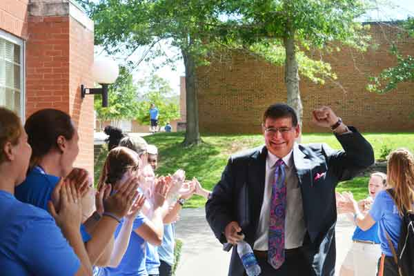 "LWC President, William T. Luckey Jr., rushes into the Freshman Kick-Off ceremony in the Roberta D. Cranmer Dining Center. Returning students formed a ""tunnel"" outside the Dining Center to welcome new students to the ceremony."