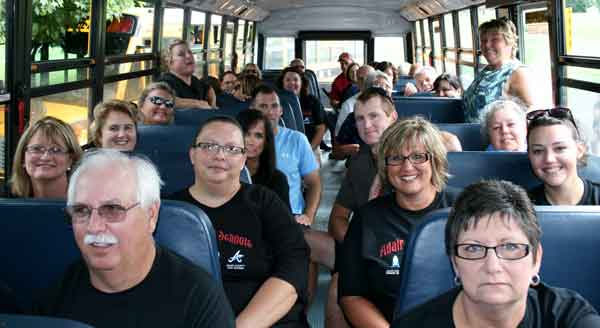"Cutline:  School employees on the No. 41 bus for Wednesday's ""Think like a Kid"" tour to kick off the new school year."