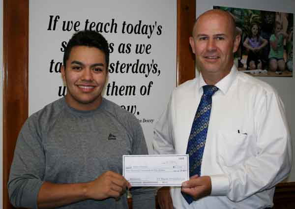 Pablo Plancarte was recently awarded two migrant scholarships for his outstanding scholastic achievement while a student in the Adair County School District.  Plancarte, a 2016 graduate of ACHS, is pictured with Federal Programs Director Steve Turner.