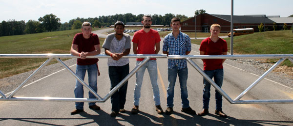 From left, Gabe Cowan, Xavier Mathis, Corey Melton, Justin Brockman, and Dillion Oglesby-Graves at the entrance of Adair County Primary Center, behind the gate they recently finished welding.