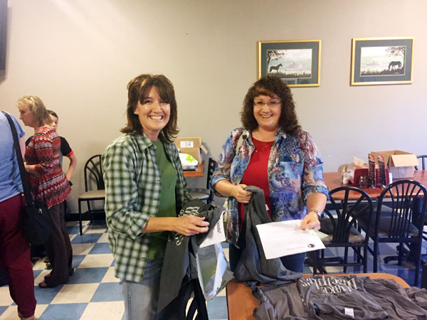 Connie Young and Christine Williams were in attendance at the OCC resource fair Thursday evening at Anderson's pizzeria. The Cane Valley Baptist Church has been active in OCC for several years.