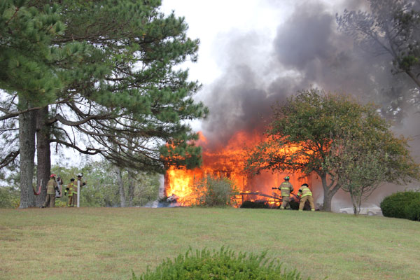 A house of Fairplay Road was fully engulfed Thursday afternoon. Photo by Beth Holmes.