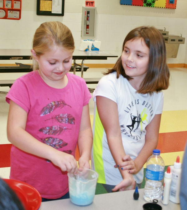 Lauren Grant and Tristan Burton made the slimy compound Gak for their science fair entry Thursday evening at Adair County Elementary School's STEM Night.